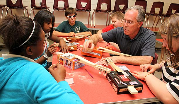 Mark Festa helping local elementary students learn the basics of string repair.