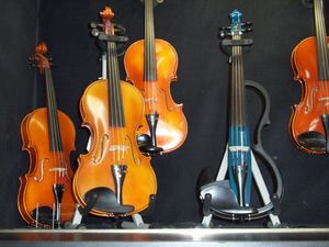 large selection of violins and electric violins
